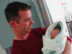Proud papa Peter Fitzpatrick with his new daughter Emma Rose - click for larger